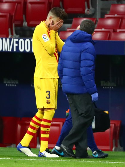 Gerard Piqué withdrew injured from the match - REUTERS / Sergio Perez