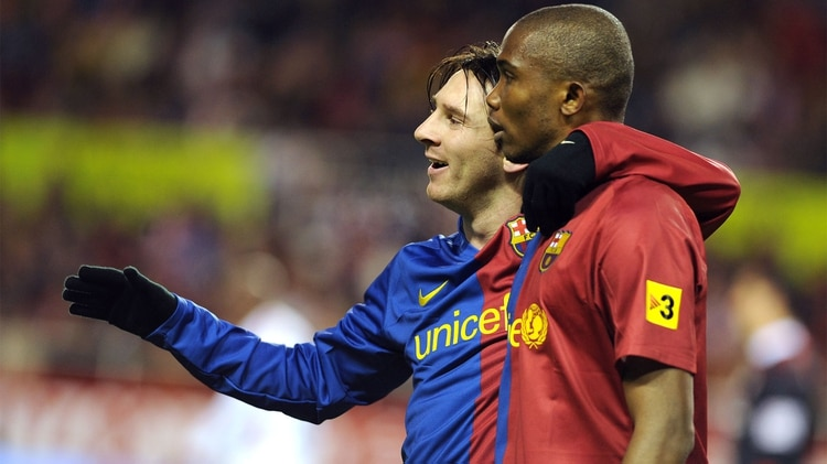 (FILES) In this file photo taken on November 29, 2008 Barcelona's Samuel Eto'o (R) celebrates after scoring against Sevilla's with Lionel Andres Messi (L) during their Spanish league football match at Sanchez Pizjuan stadium in Seville. - Cameroon's four-time African Player of the Year Samuel Eto'o announced his retirement on September 7, 2019 at the age of 38, declaring