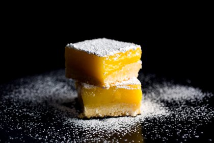 FILE - Olive oil lemon bars in New York, Jan. 8, 2015. This recipe adds extra notes of flavor to the mix: the compelling bitterness of good olive oil and a touch of sea salt sprinkled on top. (Andrew Scrivani/The New York Times)