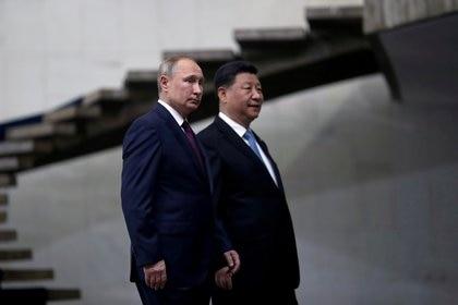 Vladimir Putin y Xi Jinping también participarán de la cumbre virtual sobre el cambio climático (REUTERS/Ueslei Marcelino)