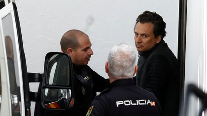 Former chief executive of Mexico's state oil firm Pemex, Emilio Lozoya, is escorted by Spanish police officers as he leaves a court after appeared in Spain's High Court via video conference, after his detention in southern Spain on Wednesday, in Marbella, Spain, February 13, 2020. REUTERS/Jon Nazca