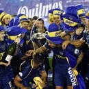 Soccer Football - Boca Juniors v Gimnasia y Esgrima La Plata - Argentine Superliga - Juan Carmelo Zerillo stadium, La Plata, Argentina - May 9, 2018 - Boca Juniors' players celebrate after clinching the Argentine Superliga championship at the end of their match against Gimnasia y Esgrima La Plata. REUTERS/Stringer