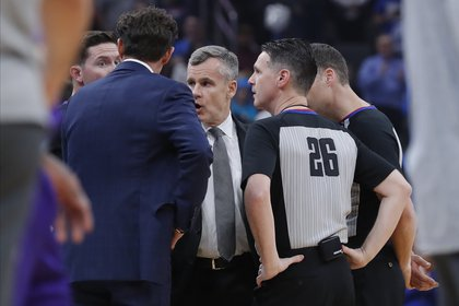 Mar 11, 2020; Oklahoma City, Oklahoma, USA; Officials talk to Oklahoma City Thunder head coach Billy Donovan (center) before tip off of a game against the Utah Jazz at Chesapeake Energy Arena. The game has been postponed to a later date. Mandatory Credit: Alonzo Adams-USA TODAY Sports
