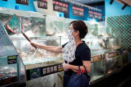 Los primeros contagios surgieron en Wuhan, China (Foto: REUTERS/Aly Song)