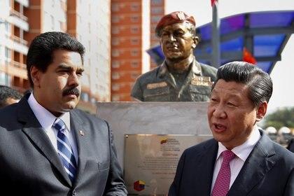 Xi Jinping y Nicolás Maduro. Foto: REUTERS/Carlos Garcia Rawlins
