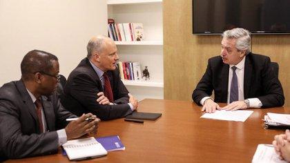 Alberto Fernández junto a Alejandro Werner, director del Departamento para el Hemisferio Occidental del FMI y Trevor Alleyne
