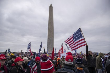 Demonstrators gather during a protest at the Washington Monument on Jan. 6. Photographer: Victor J. Blue/Bloomberg