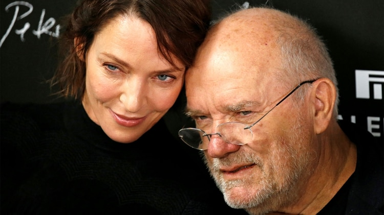 FILE PHOTO: Photographer Peter Lindbergh (R) and actress Uma Thurman (L) attend a photocall for the launching of the Pirelli Calendar 2017 in Paris, France, November 29, 2016. REUTERS/Charles Platiau/File Photo