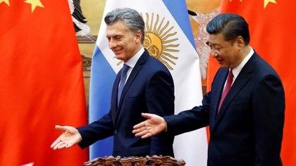 El presidente Macri, junto a su par chino, Xi Jinping , en Beijing el año pasado