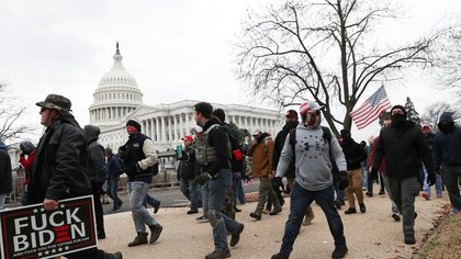SENSITIVE MATERIAL. THIS IMAGE MAY OFFEND OR DISTURB Members of the the far-right group Proud Boys march to the U.S. Capitol Building in Washington, U.S., January 6, 2021. REUTERS/Leah Millis