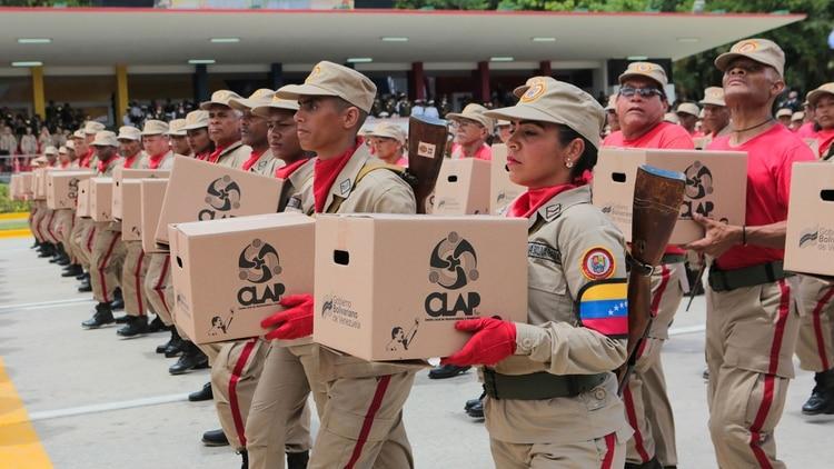 Las milicias potan las cajas CLAP (Reuters)