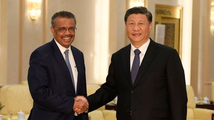 Tedros Adhanom, director general of the World Health Organization, shakes hands with Xi Jinping before a meeting at the Great Hall of the People in Beijing, China, on January 28, 2020. There they discussed the coronavirus outbreak that would lead to check the world in a matter of months (Reuters)