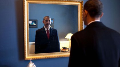 Mandatory Credit: Photo by Everett/Shutterstock (10291139a)President-elect Barack Obama checks himself in a mirror before taking the oath of office at the U.S. Capitol. Jan. 20 2009.,Historical Collection