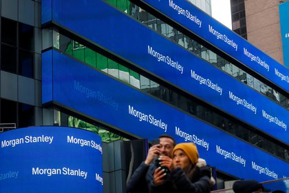 People take photos by the Morgan Stanley building in Times Square in New York City, New York U.S., February 20, 2020. REUTERS/Brendan McDermid