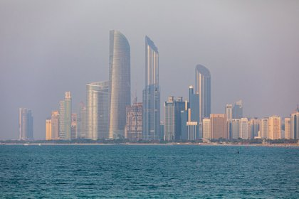 Commercial and residential skyscrapers stand along the coastline in Abu Dhabi, United Arab Emirates, on Wednesday, Oct. 2, 2019. Abu Dhabi sold $10 billion of bonds in a three-part deal in its first international offering in two years as it takes advantage of relatively low borrowing costs. Photographer: Christopher Pike/Bloomberg