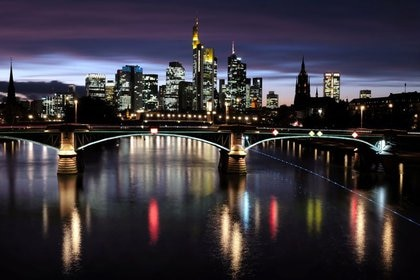 FILE PHOTO: The skyline with its financial district is photographed during sunset as the spread of the coronavirus disease (COVID-19) continues in Frankfurt, Germany, October 26, 2020, REUTERS/Kai Pfaffenbach