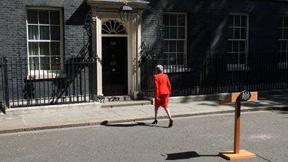 Theresa May (Photo by ISABEL INFANTES / AFP)