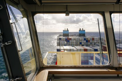 Shipping containers sit aboard the Maersk Mc-Kinney Moeller Triple-E Class container ship, operated by A.P. Moeller-Maersk A/S, as it sails on the North Sea between Rotterdam in the Netherlands and Bremerhaven, Germany, on Monday, Nov. 11, 2013. A.P. Moeller-Maersk A/S's container-shipping line, the world's largest, reported an 11 percent increase in third-quarter profit after cost cuts countered a decline in freight rates.