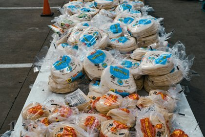 H-E-B branded foods at a distribution center set up by the San Antonio Food Bank in San Antonio, Texas, on Sunday, Feb. 21, 2021. For many Texans, H-E-B reflects the ways the state's maverick spirit can flourish: reliable for routine visits but particularly in a time of disaster, and a belief that the family-owned grocery chain has made a conscious choice to stay rooted to the idea of being a good neighbor. (Christopher Lee/The New York Times)