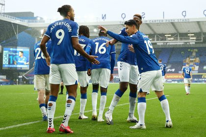 Soccer Football - Premier League - Everton v Brighton & Hove Albion - Goodison Park, Liverpool, Britain - October 3, 2020 Everton's James Rodríguez celebrates scoring their third goal with Dominic Calvert-Lewin and teammates Pool via REUTERS/Jan Kruger EDITORIAL USE ONLY. No use with unauthorized audio, video, data, fixture lists, club/league logos or 'live' services. Online in-match use limited to 75 images, no video emulation. No use in betting, games or single club /league/player publications.  Please contact your account representative for further details.