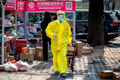 El coronavirus comenzó a contagiarse en el mercado de animales de Wuhan, en China, y ya se expandió a varios países del mundo  (Photo by NICOLAS ASFOURI / AFP)