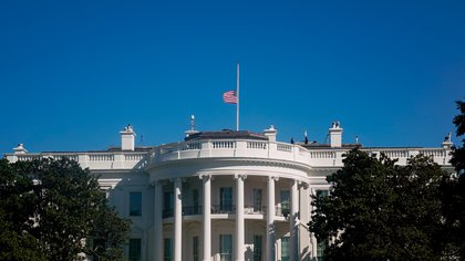 The American flag above the White House is seen at half staff after the death of Supreme Court Justice Ruth Bader Ginsburg, in Washington, U.S. September 20, 2020. REUTERS/Erin Scott