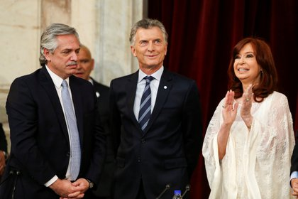 Alberto Fernandez looks on next to new Vice President Cristina Fernandez and Argentina's former President Mauricio Macri, after he sworn in as Argentina's new President, at the National Congress, in Buenos Aires, Argentina December 10, 2019. REUTERS/Agustin Marcarian