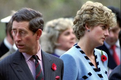 Diana B. and Prince Charles look in different directions at a service in honor of 59 British soldiers who died during the Korean War on November 3.