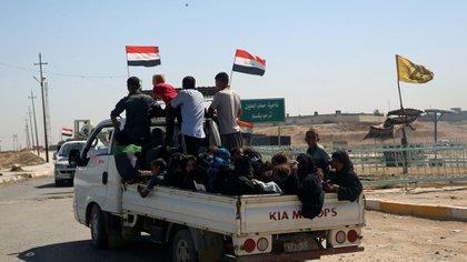 Civiles desplazados retornan a Mosul (Reuters)