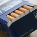 FILE PHOTO: Pall Mall cigarettes are seen after the manufacturing process in the British American Tobacco Cigarette Factory (BAT) in Bayreuth, southern Germany, April 30, 2014. REUTERS/Michaela Rehle/File Photo