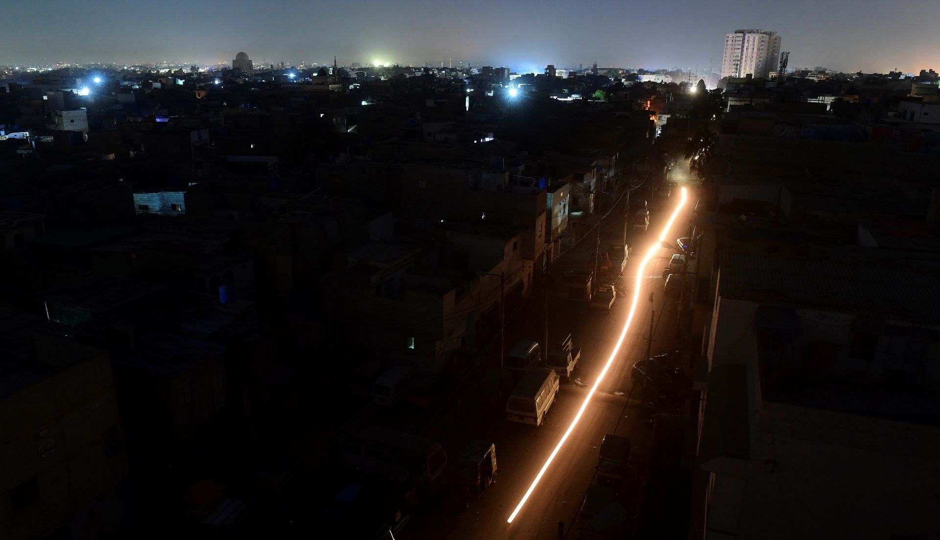 A general view shows Pakistan's port city of Karachi during a power blackout early on January 10, 2021. (Photo by Asif HASSAN / AFP)