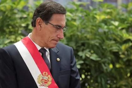FILE PHOTO: Peru's President Martin Vizcarra attends a swearing-in ceremony at the government palace in Lima, Peru October 3, 2019. REUTERS/Guadalupe Pardo/File Photo