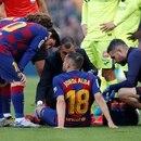 Soccer Football - La Liga Santander - FC Barcelona v Getafe - Camp Nou, Barcelona, Spain - February 15, 2020 Barcelona's Jordi Alba talks to Lionel Messi as he receives medical attention after sustaining an injury REUTERS/Albert Gea