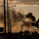 "Smoke from burning cars rises amid a gunfight in Culiacan, Mexico, Thursday, Oct. 17, 2019. An intense gunfight with heavy weapons and burning vehicles blocking roads raged in the capital of Mexico's Sinaloa state Thursday after security forces located one of Joaquín ""El Chapo"" Guzmán's sons who is wanted in the U.S. on drug trafficking charges. (AP Photo/Augusto Zurita)"