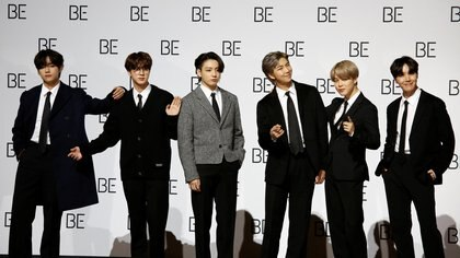 """Members of K-pop boy band BTS pose for photographs during a news conference promoting their new album """"BE(Deluxe Edition)"""" in Seoul, South Korea, November 20, 2020.    REUTERS/Heo Ran"""