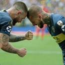 Boca Juniors' Dario Benedetto (R) celebrates with Uruguayan teammate Nahitan Nandez after scoring the team's second goal against River Plate during their first leg match of the all-Argentine Copa Libertadores final, at La Bombonera stadium in Buenos Aires, on November 11, 2018. (Photo by Alejandro PAGNI / AFP)