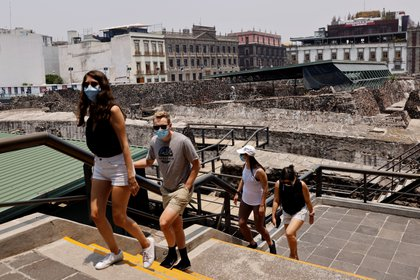 Tourists are seen at the archeological site Templo Mayor as it re-opens after almost a year of closures due to the coronavirus disease (COVID-19) pandemic, in Mexico City, Mexico April 28, 2021. REUTERS/Carlos Jasso