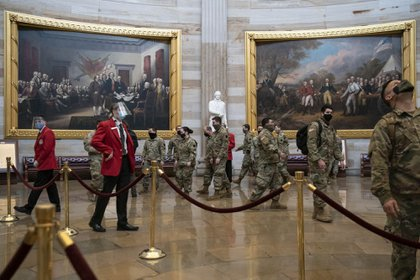 Members of the National Guard tour the U.S. Capitol Rotunda in Washington, D.C., U.S., on Monday, Jan. 25, 2021. Donald Trump's trial in the Senate will kick off today when House impeachment managers deliver their single article accusing him of inciting the Jan. 6 Capitol that left five people including a police officer dead.