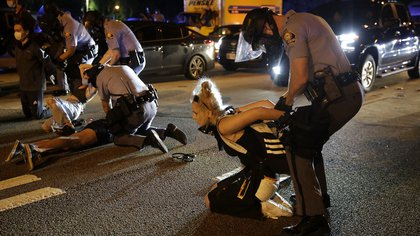 People are detained during protests Saturday, June 13, 2020, near the Atlanta Wendy's where Rayshard Brooks was shot and killed by police Friday evening following a struggle in the restaurant's drive-thru line in Atlanta. (AP Photo/Brynn Anderson)