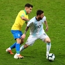 Soccer Football - Copa America Brazil 2019 - Semi Final - Brazil v Argentina - Mineirao Stadium, Belo Horizonte, Brazil - July 2, 2019 Argentina's Lionel Messi in action with Brazil's Philippe Coutinho REUTERS/Pilar Olivares