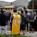 Laker fans gather near the helicopter crash site that killed nine people including retired basketball star Kobe Bryant and one of his daughters in Calabasas, California, U.S., January 26, 2020. REUTERS/Gene Blevins