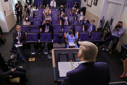 U.S. President Donald Trump listens to a question from ABC News reporter Jonathan Karl he holds a coronavirus disease (COVID-19) response news briefing at the White House in Washington, U.S., July 21, 2020. REUTERS/Leah Millis
