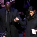 Former basketball player Michael Jordan helps Vanessa Laine Bryant get off the stage during a public memorial for her late husband, NBA great Kobe Bryant, her daughter Gianna and seven others killed in a helicopter crash on January 26, at the Staples Center in Los Angeles, California, U.S., February 24, 2020. REUTERS/Lucy Nicholson