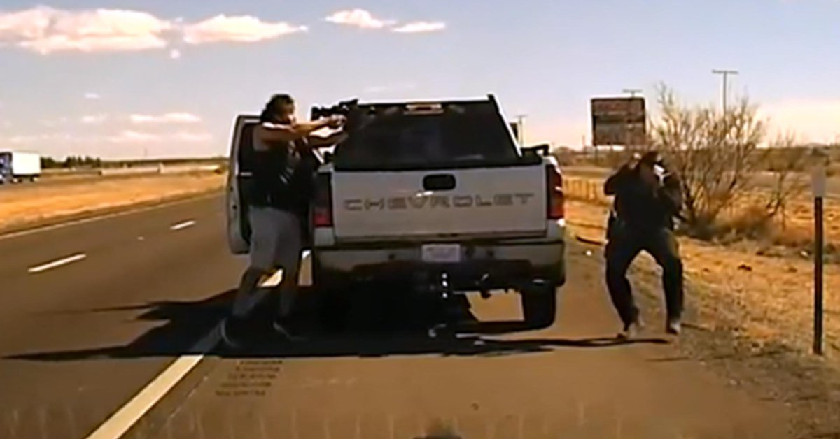 The moment when a New Mexico police officer was cowardly shot by a fugitive