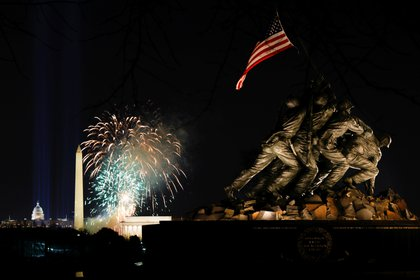 """Fireworks are seen over the National Mall during the event """"Celebrating America"""" at the Lincoln Memorial in Washington, after the inauguration of Joe Biden as the 46th President of the United States."""
