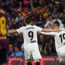 Valencia's Spanish forward Rodrigo Moreno (R) celebrates with Valencia's French forward Kevin Gameiro after scoring his team's second goal during the 2019 Spanish Copa del Rey (King's Cup) final football match between Barcelona and Valencia on May 25, 2019 at the Benito Villamarin stadium in Sevilla. (Photo by JOSE JORDAN / AFP)