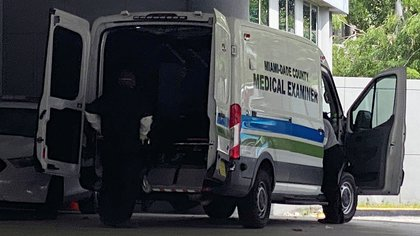 A body is loaded into a Miami-Dade County Medical Examiner's van outside Jackson Health Center, where coronavirus disease (COVID-19) patients are treated, in Miami, Florida, U.S. July 13, 2020.  REUTERS/Liza Feria