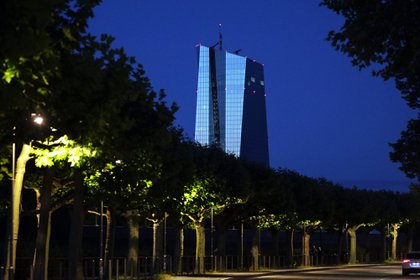 The European Central Bank (ECB) headquarters stand illuminated at night in Frankfurt, Germany, on Monday, June 29, 2020. A broad coalition of ruling and opposition parties in Germany has agreed on a draft motion to back the European Central Bank's bond buying program, according to officials familiar with the accord, likely ending a standoff that was triggered by the country's constitutional court last month.
