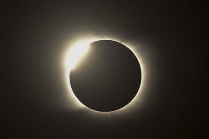 The diamond ring effect is seen during the total solar eclipse from Piedra del Aquila, Neuquen province, Argentina on December 14, 2020. (Photo by RONALDO SCHEMIDT / AFP)