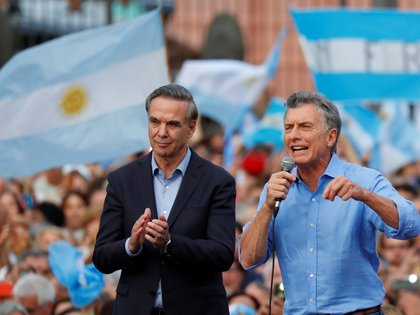 Argentina's outgoing president Mauricio Macri and his running mate Miguel Angel Pichetto greet supporters outside the Casa Rosada presidential palace during a rally in Buenos Aires, Argentina, December 7, 2019. REUTERS/Agustin Marcarian